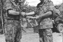 1986 Kenya CSgt Brook handing fun run proceeds to Padre