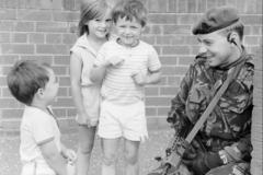 1999 UK NI Street patrol with friendly Locals