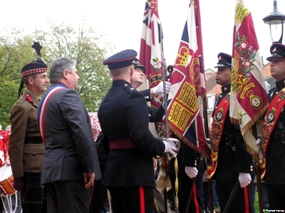 The Mayor is Shown The Battle Honour 'LYS' emblazoned on the Queens Colour